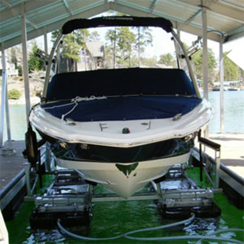 boat lift on a custom Kroeger Marine boat dock with a boat lifted out of the water