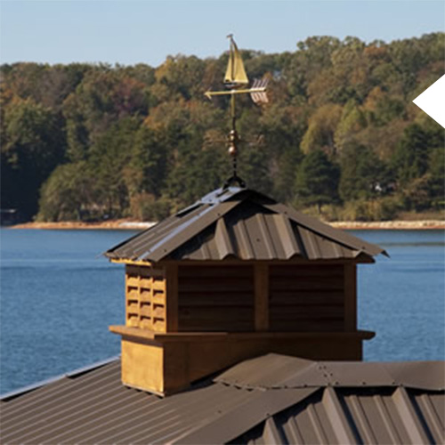 Cupola on a dark brown dock on the lake in south carolina