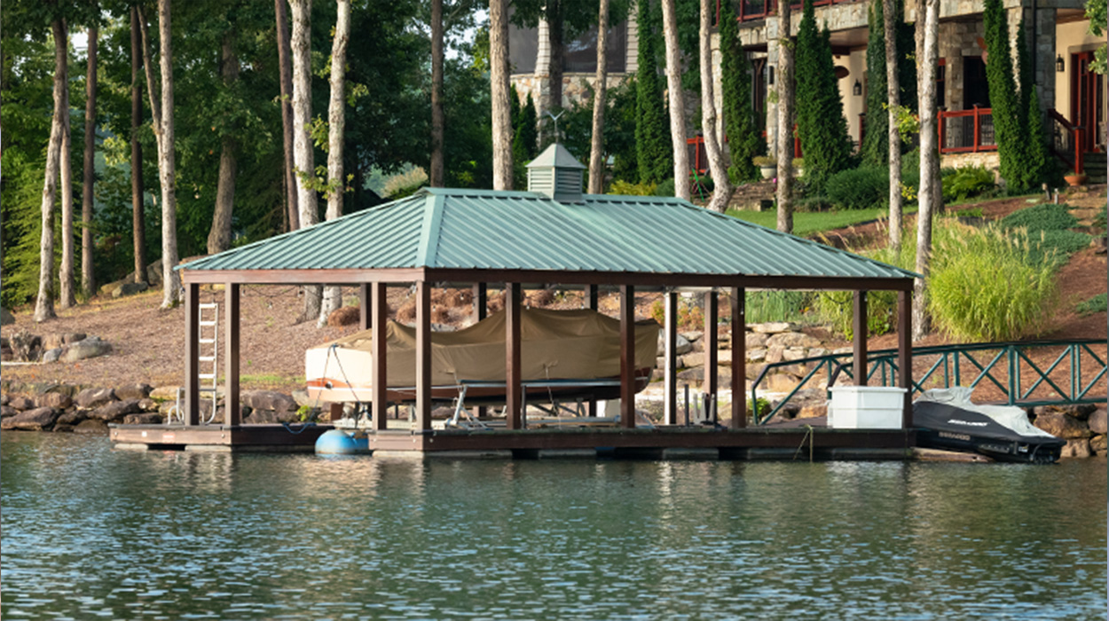 Dock on lake keowee with green roof