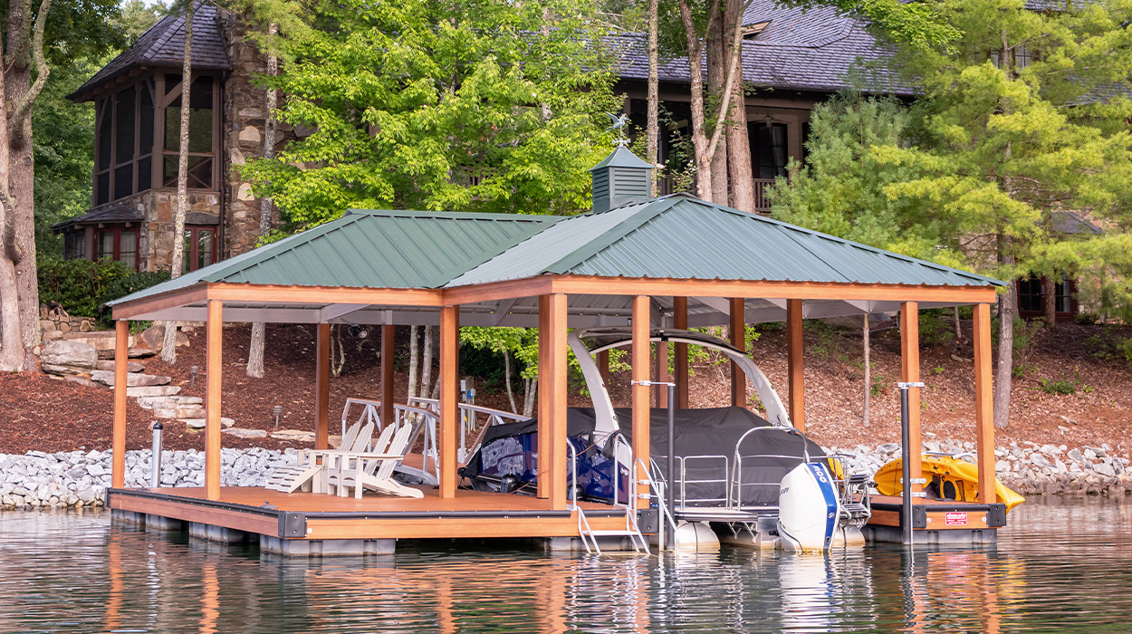 Pontoon boat covered by wooden boat dock
