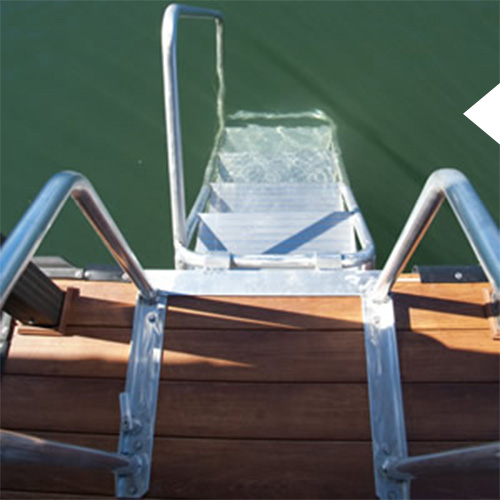 Swim ladder on a dock. Ladder is going into the water