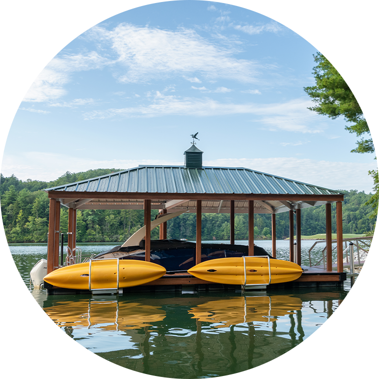 Customer built dock by Kroeger Marine. Green roof with two yellow kayak