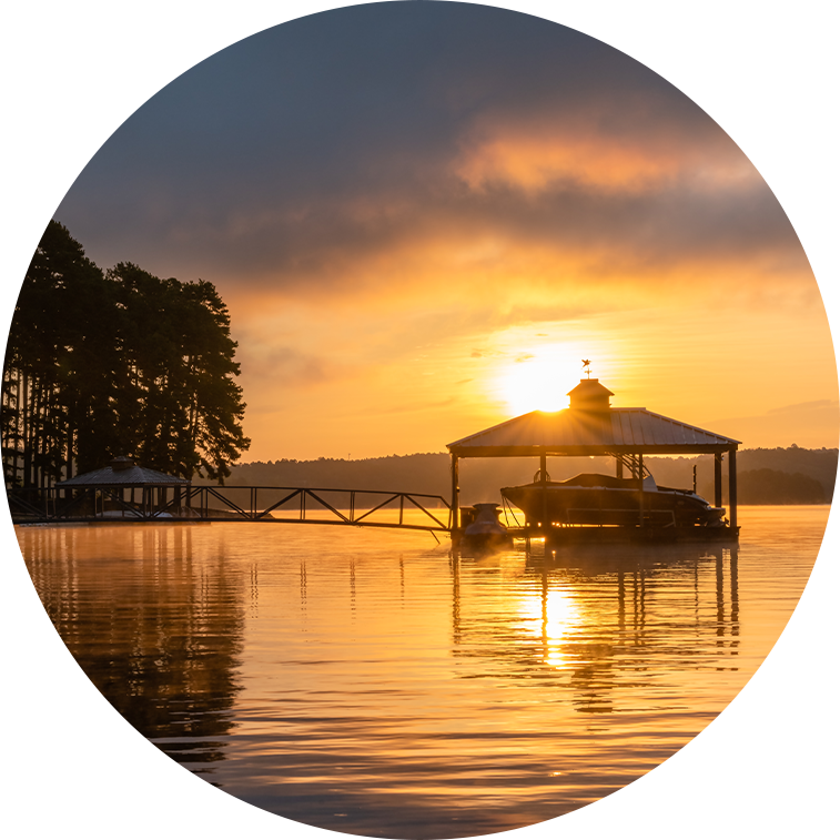 circle picture of a sunset over a dock on Lake Hartwell built by Kroeger Marine