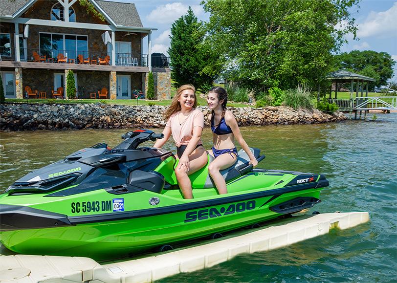 two girls on green sea doo