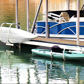 white kayak stored on a wooden dock in the lake