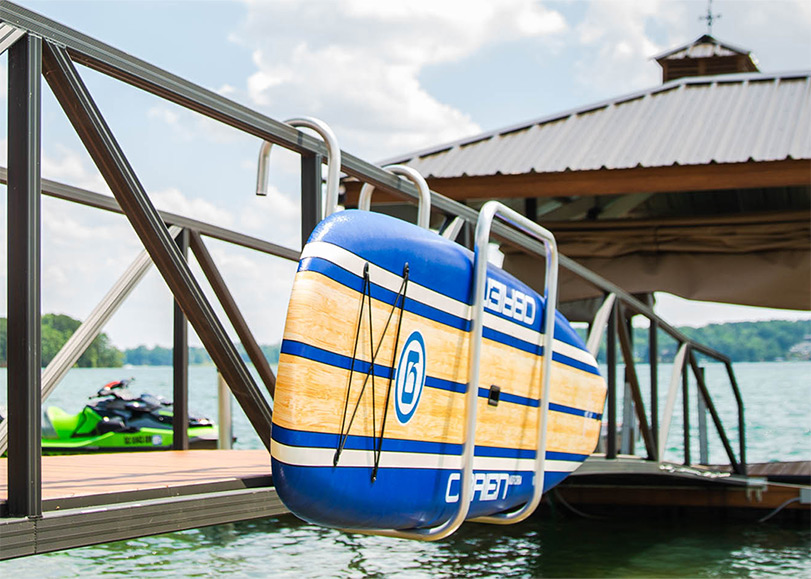 paddle board stored on boat dock